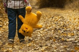 Image of a child walking while carrying a stuffed animal, representing the announcement of a new NJ child relocation standard in an article by an experienced Monmouth County divorce attorney